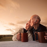 elderly-couple-sunset-coffee